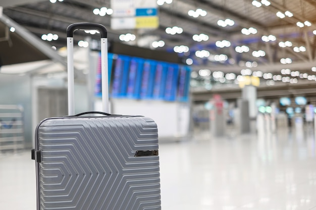 Luggage bag in international airport terminal background