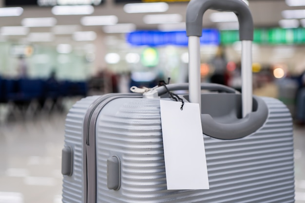Luggage holder tag blank label on suitcase, baggage put letter for transport.