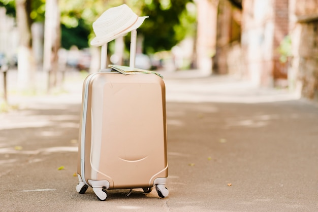 Luggage standing with hat on top