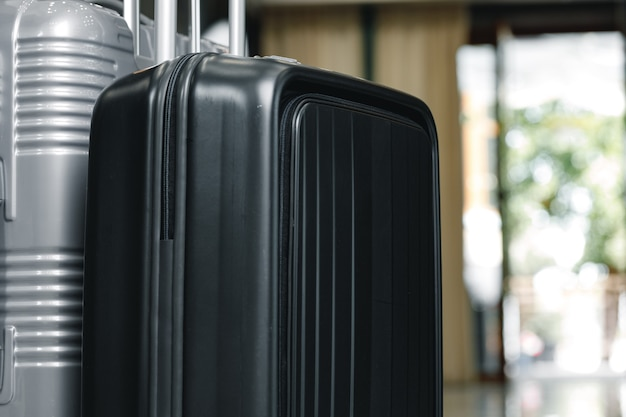 Luggage suitcase for trips standing in hotel lobby close up