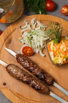 Lula kebab with pickled onions and cabbage salad