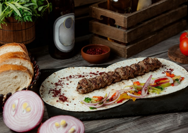 Lule kebab with onion salad in lavash