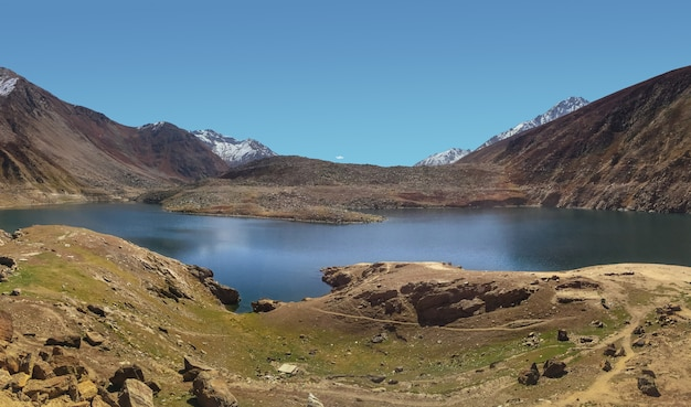Lulusar lake with snow capped mountain range, pakistan.