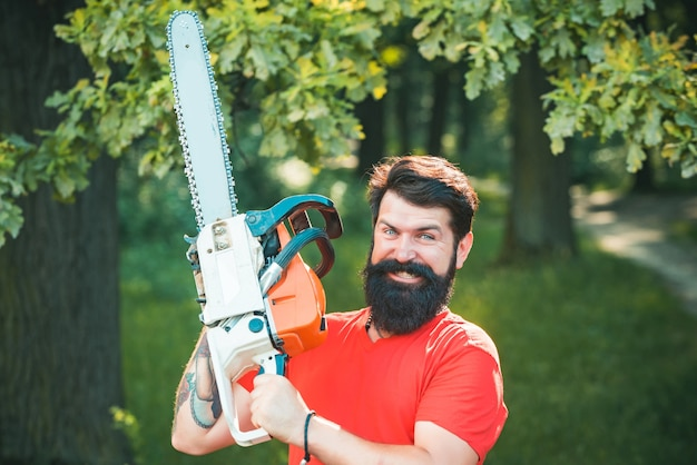 Lumberjack in the woods with chainsaw axe