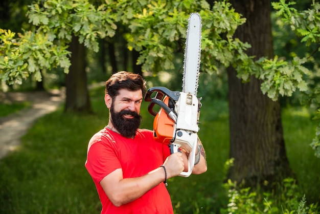 Lumberjack worker walking in the forest with chainsaw agriculture and forestry theme illegal logging...