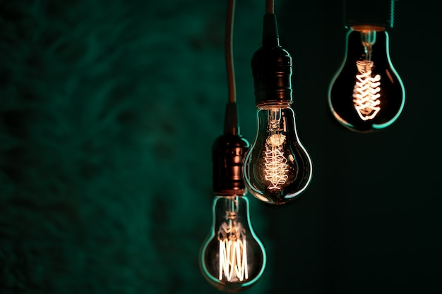 Luminous lamps hang in the dark. decor and atmosphere concept.