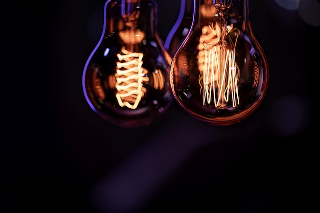 Luminous lamps hang in the dark from the boke. decor and atmosphere concept.
