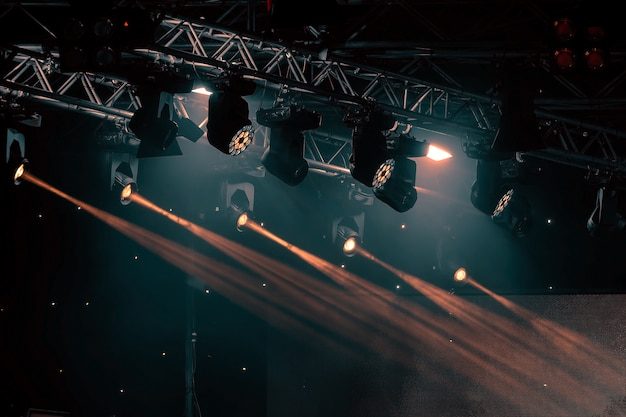 Luminous rays from concert lighting against a dark background