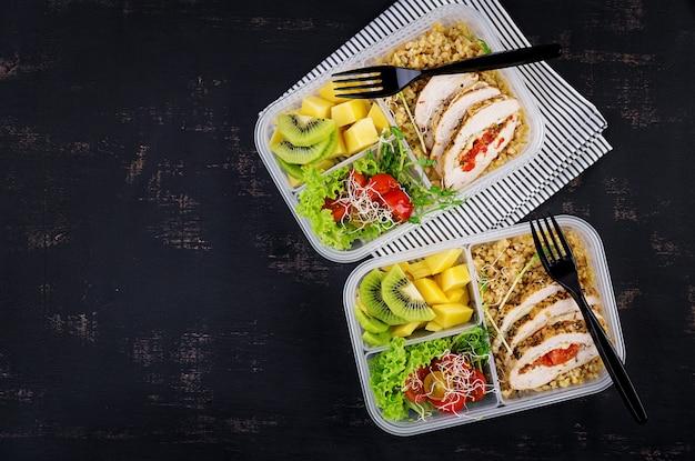 Lunch box  chicken, bulgur, microgreens, tomato  and fruit.
