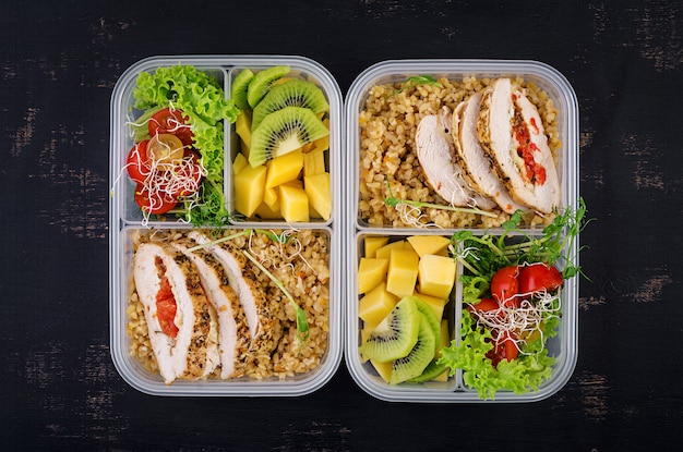 Lunch box  chicken, bulgur, microgreens, tomato and fruit.