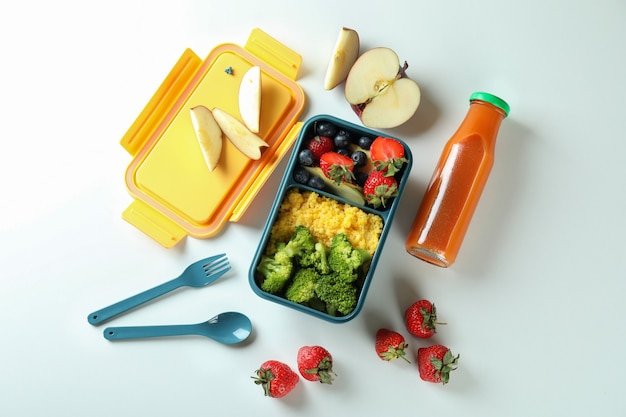 Lunch box with tasty food on white background