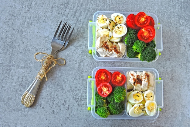 Lunch boxes with a healthy meal. vegetables, quail eggs and chicken breast. lunch boxes to go