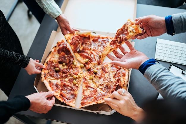 Lunch break. eating pizza.