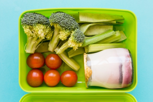 Lunchbox with yogurt and vegetables