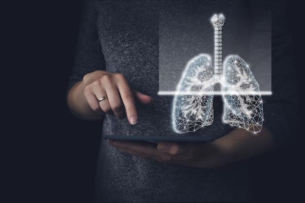 暗い背景の肺。多角形のワイヤーフレーム構成。粒子がつながっている