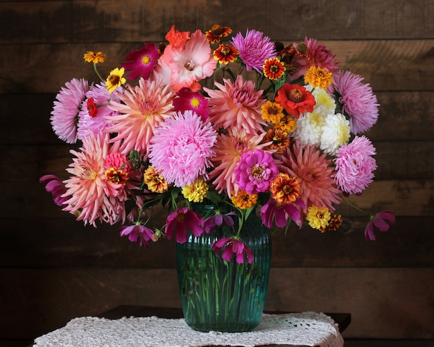Lush bouquet of autumn garden flowers in a vase. asters and dahlias.