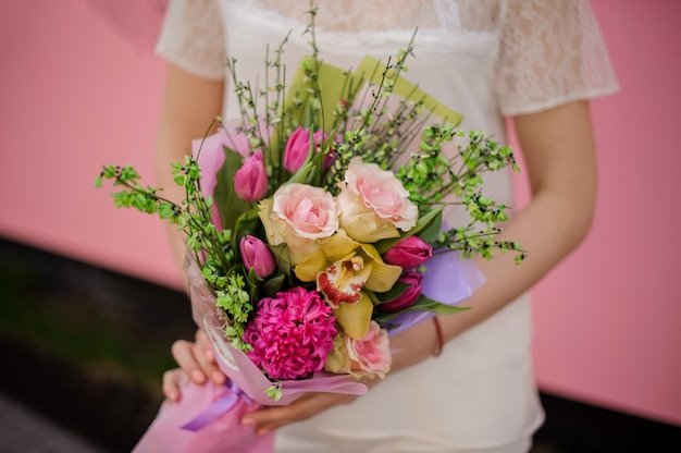 Lush bouquet of roses, iris and tulips