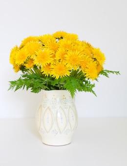 Lush bouquet of yellow dandelions