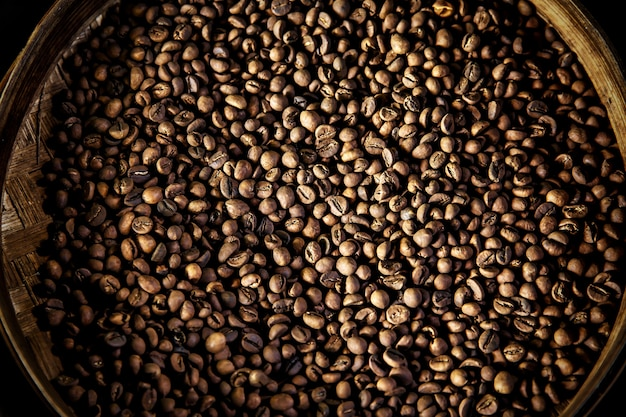 Luwak coffee beans in a round container. top view. the legendary coffee from bali, indonesia