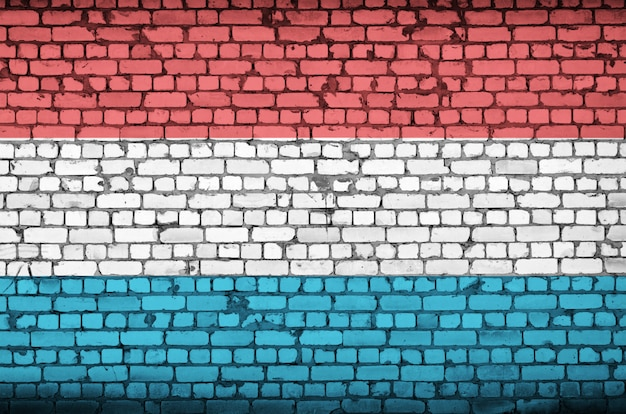 Luxembourg flag is painted onto an old brick wall