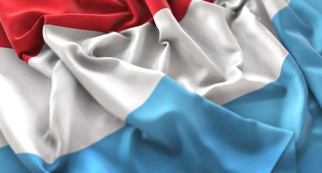 Luxembourg flag ruffled beautifully waving macro close-up shot