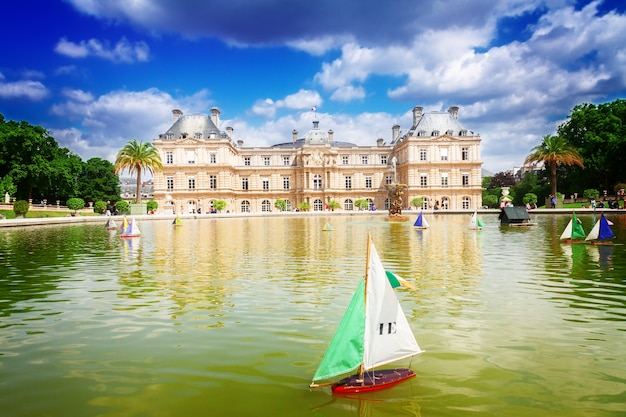 Luxembourg garden with large pond, paris, france, retro toned