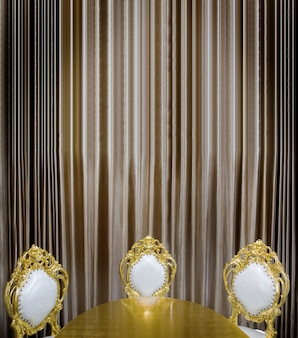 Luxuary golden table and seat decoration in dining room