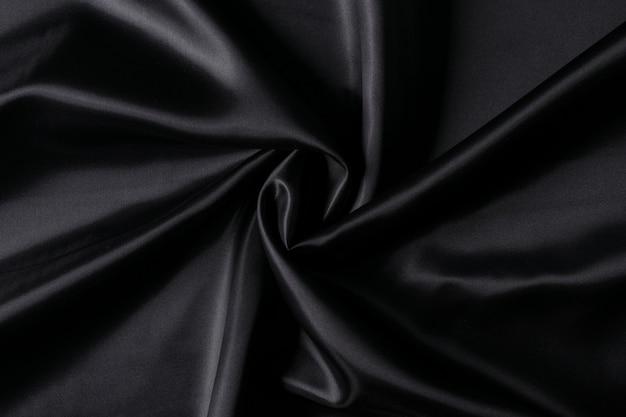 Роскошная ткань черного цвета.
