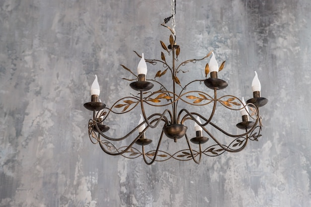 Luxurious black metal chandelier hanging on the ceiling.contemporary chandelier, ornamental light fixture designed to be mounted on ceilings or walls. home interior