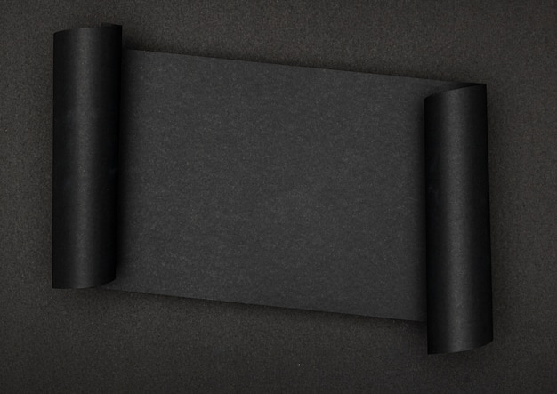 Luxurious black piece of paper on black background