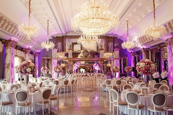 Luxurious dinner hall with large crystal chandelier