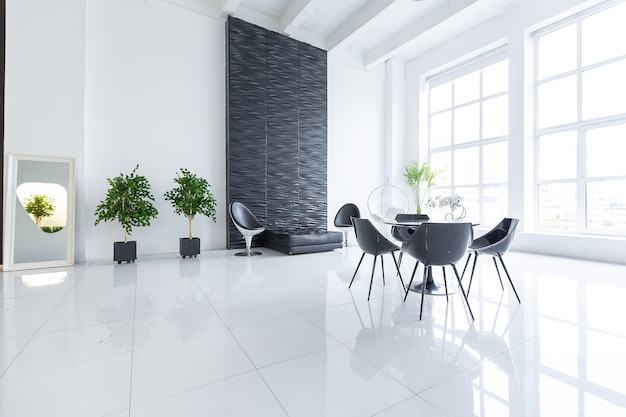 Luxurious futuristic trendy modern interior in contrasting black and white colors with interesting fashionable black furniture and decorated wall