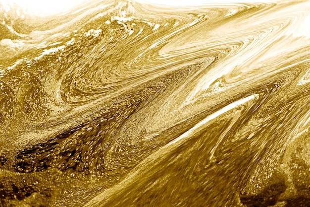 豪華な金色の流体テクスチャ背景