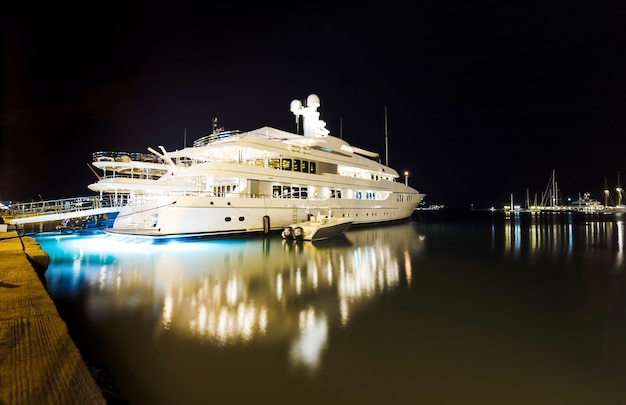 Luxurious modern private yacht at the pier at night. zakynthos, greece, shallow dof