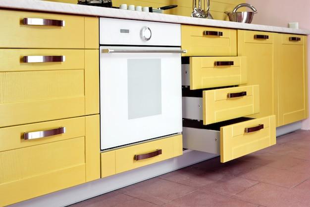 Luxurious new beige  kitchen with modern appliances Premium Photo