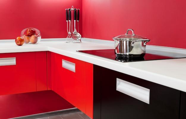 Luxurious new red kitchen with modern appliances Premium Photo