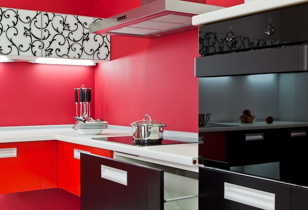 Luxurious new red kitchen with modern appliances Premium Photo