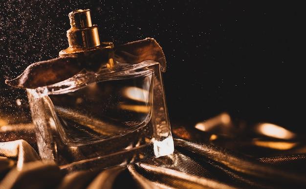 Luxurious perfume on golden fabric