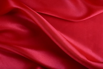 Luxurious red satin fabric with beautiful patterns.