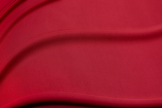 Luxurious red viscose or silk fabric. background and pattern.
