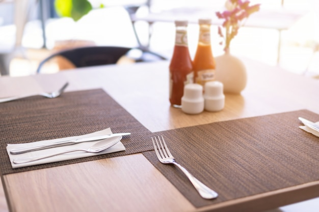 Luxurious spoon and fork sauce bottle the dining table decoration in hotel
