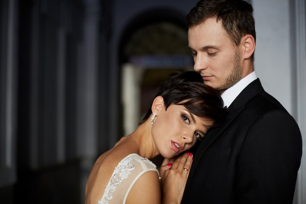 Luxurious stylish young bride and groom