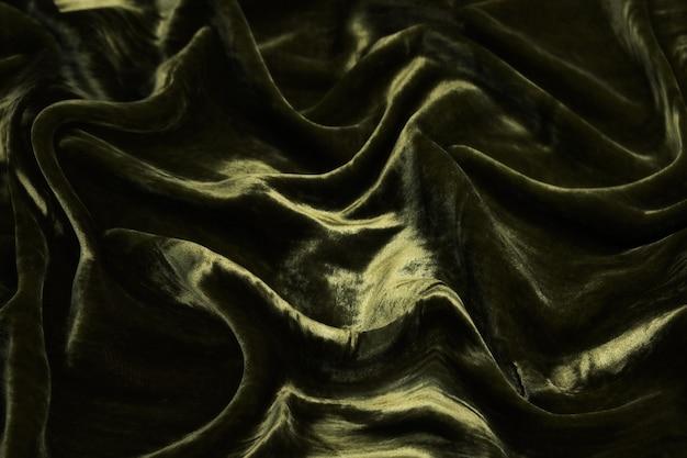 Роскошные волны болотного цвета бархатной ткани фона.
