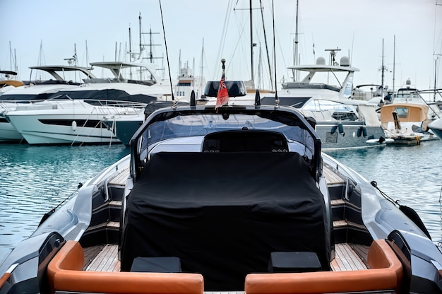 Luxurious yachts in a port in the evening
