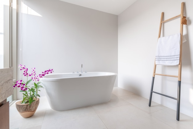 Luxury bathroom features bathtub with flower