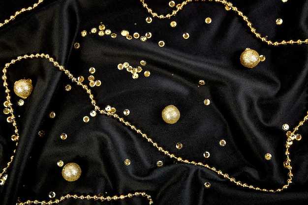 Luxury black background with gold  shiny balls.