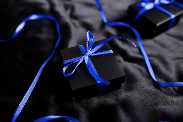 Luxury black gift boxes with blue ribbon