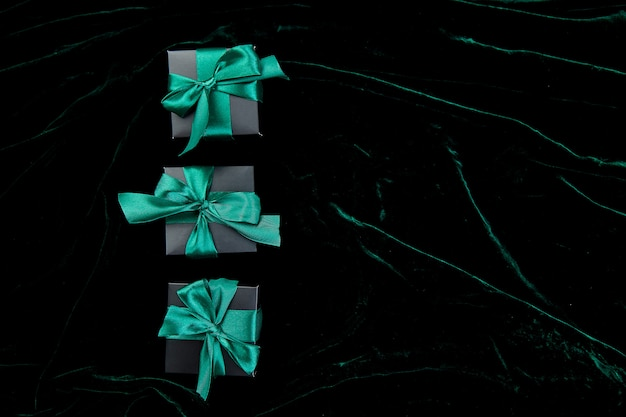 Luxury black gift boxes with emerald ribbon