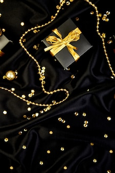 Luxury black gift boxes with gold ribbon