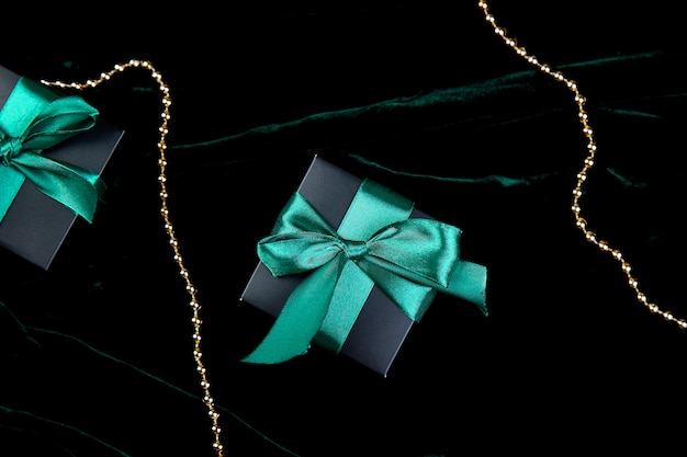 Luxury black gift boxes with green ribbon